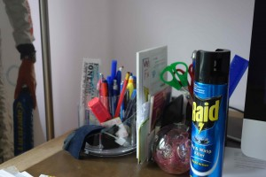Desk with fly spray