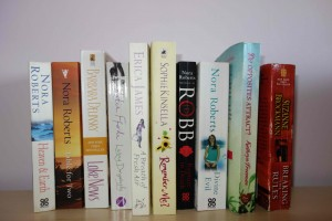 My book on shelf with others
