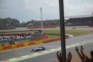 Lewis Hamilton takes the chequered flag at Silverstone